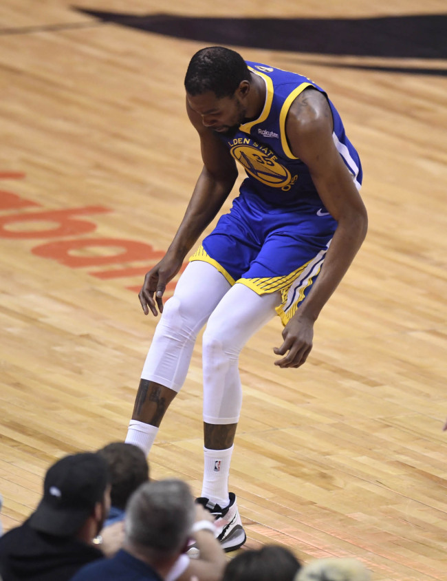 Golden State Warriors forward Kevin Durant (35) hobbles after injuring his right leg during first-half basketball action in Game 5 of the NBA Finals against the Toronto Raptors in Toronto, Monday, June 10, 2019. [Photo: Frank Gunn/The Canadian Press via IC]