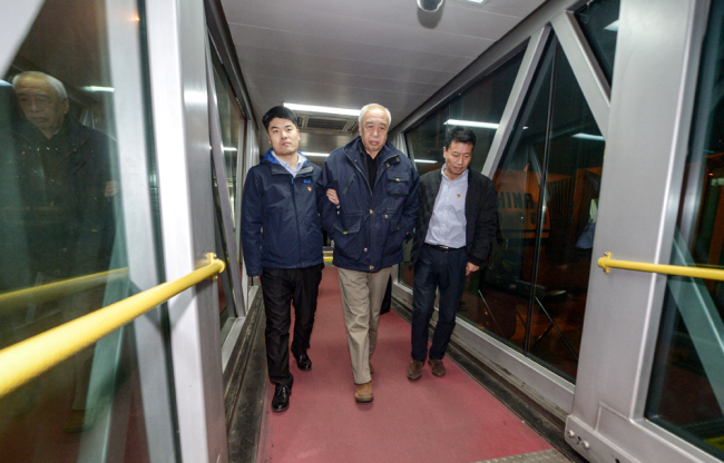 Jiang Wei, former top-ranking official at the China Association of Automobile Manufacturers, who was on the run in New Zealand for corruption, arrives as he is repatriated in Beijing on December 14, 2018. [Photo: IC]