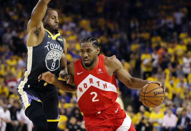 In this June 13, 2019, file photo, Toronto Raptors forward Kawhi Leonard (2) drives against Golden State Warriors forward Andre Iguodala (9) during the first half of Game 6 of basketball's NBA Finals in Oakland, California, U.S. [Photo: IC]