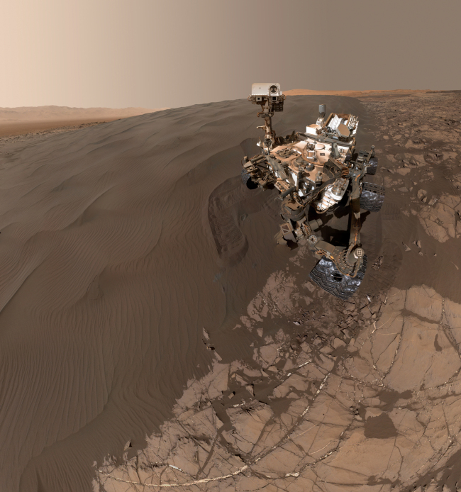 """Self-portrait of NASA's Curiosity Mars rover shows the vehicle at """"Namib Dune, """" where the rover's activities included scuffing into the dune with a wheel and scooping samples of sand for laboratory analysis. The scene combines 57 images taken on Jan. 19, 2016.[Photo: NASA/Cover Images via IC]"""