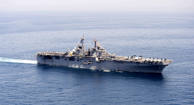 A handout image released by the U.S. Navy Media Content Operations shows the amphibious assault ship USS Boxer (LHD 4) transits the Arabian Gulf to conduct missions in support of Operation Inherent Resolve, at an undisclosed location in the Arabian Gulf, June 16, 2016. [File photo: IC]