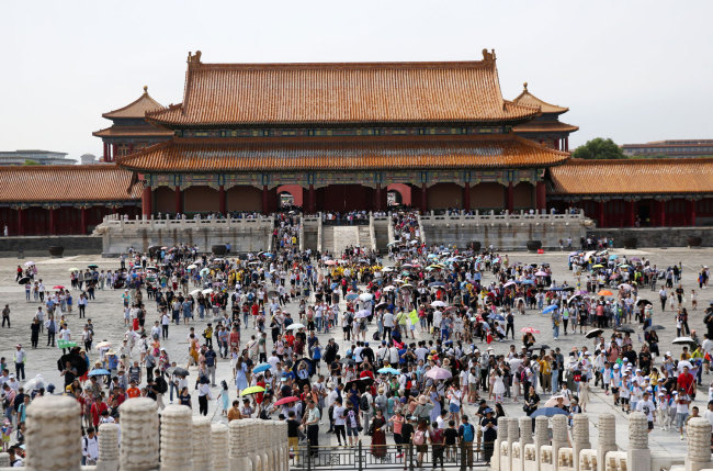 Tourists visit the Palace Museum, also known as the Forbidden City, during the peak of the summer holiday in Beijing on Sunday, July 7, 2019. [Photo: IC]