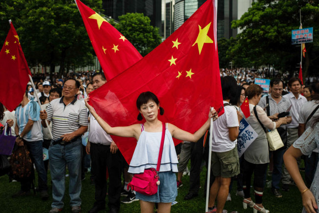 People rally to oppose violence at a park in Hong Kong on July 20, 2019. [File photo: IC]