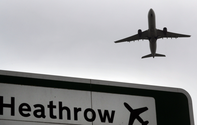In this file photo dated Tuesday, June 5, 2018, a plane takes off over a road sign near Heathrow Airport in London. [File Photo: AP via IC/Kirty Wigglesworth]