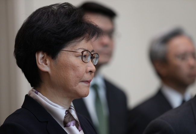 Hong Kong Chief Executive Carrie Lam (L) speaks during a press conference in Hong Kong, August 5, 2019. [Photo: EPA via IC/JEROME FAVRE]