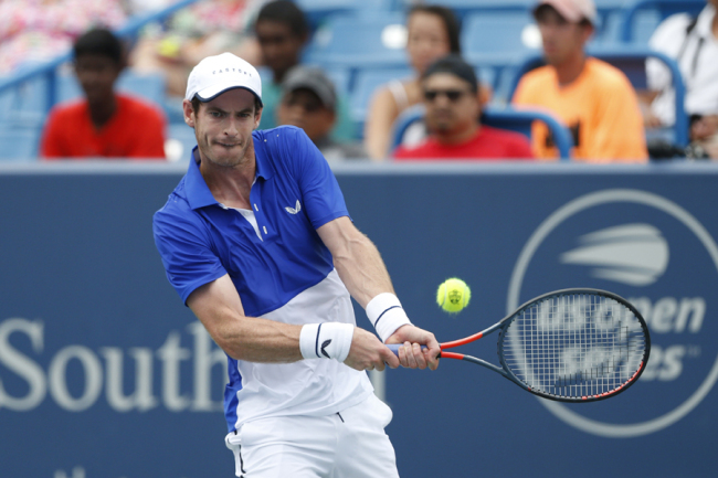 Andy Murray, of Great Britain, returns a backhand against Richard Gasquet, of France, during first round play at the Western & Southern Open tennis tournament, Monday, Aug. 12, 2019, in Mason, Ohio.  [Photo: IC]