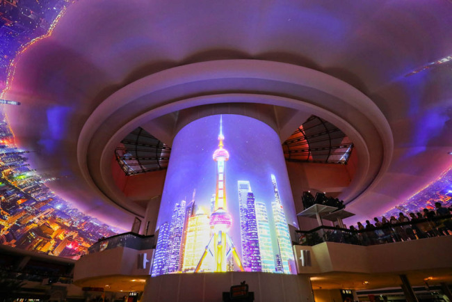 Shanghai's Oriental Pearl Radio and Television Tower is now showcasing three dome projection shows every night this month. [Photo: IC]