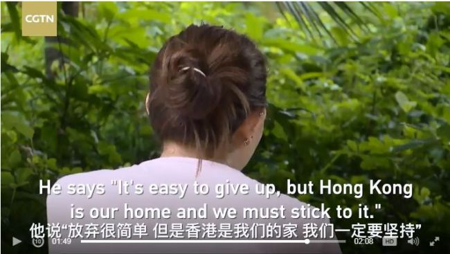 The screen shot from cgtn.com shows a wife of a Hong Kong policeman receiving an interview. [Photo: China Plus]