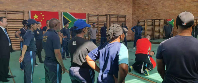 Two trainers from Fujian Police College demonstrates combat techniques to officers from the Johannesburg Metro Police Department. [Photo: Joburg Public Safety]