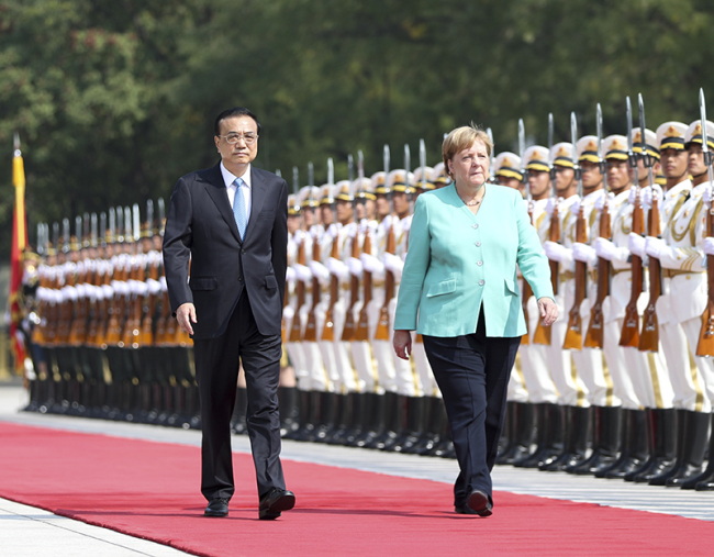 Premier Li Keqiang holds a welcome ceremony at the east plaza of the Great Hall of the People for German Chancellor Angela Merkel, who is on her 12th official visit to China, on Friday, Sept 6, 2019. [Photo: gov.cn]