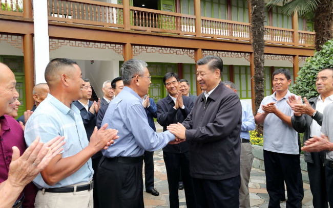 Xi Jinping, general secretary of the Communist Party of China Central Committee, shakes hands with the family members of martyrs during an inspection tour in central China's Henan Province on September 16, 2019. [Photo: Xinhua/Ju Peng]