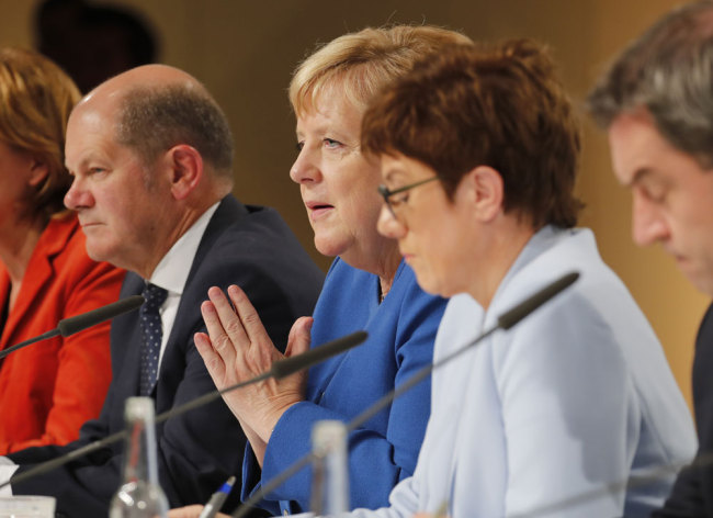 (L to R) German Finance Minister and Vice-Chancellor Olaf Scholz, German Chancellor Angela Merkel, German Defence Minister Annegret Kramp-Karrenbauer and Bavaria's State Premier and leader of the Bavarian Christian Social Union (CSU) Markus Soeder attend a press conference after a climate committee meeting at the Futurium on September 20, 2019 in Berlin. [Photo: AFP/Axel Schmidt]