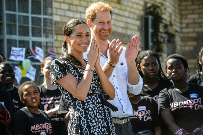 "Prince Harry, Duke of Sussex and Meghan, Duchess of Sussex arrive to visit the ""Justice desk"", an NGO in the township of Nyanga in Cape Town, as they begin their tour of the region on September 23, 2019. [Photo: AFP]"