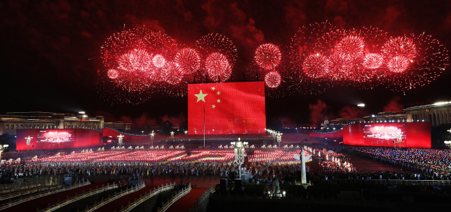 Fireworks sprout from the eastern and western ends of Tian'anmen Square and converge in the night sky in Beijing on Tuesday, October 1, 2019. Tian'anmen Square hosted a grand evening gala to celebrate the 70th anniversary of the founding of the People's Republic of China. [Photo: VCG]