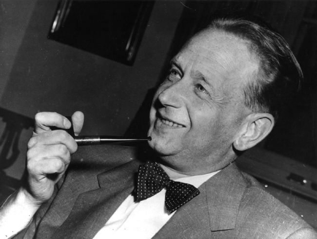 In this May 19, 1953, file ., Dag Hammarskjold, recently appointed secretary general of the United Nations who is on a visit to Sweden, smokes his pipe at a press conference held at the Foreign Office in Stockholm. [Photo: IC]