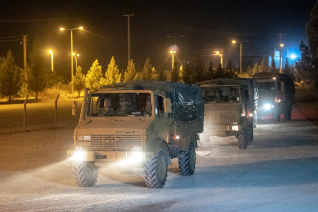 Turkish army soldiers drive towards the border with Syria near Akcakale in Sanliurfa province on October 8, 2019. [Photo: AFP]