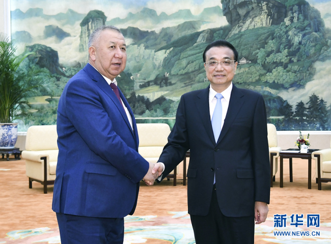 Chinese Premier Li Keqiang meets with Kyrgyz First Deputy Prime Minister Kubatbek Boronov in Beijing, on Wednesday, October 09, 2019. [Photo: Xinhua]