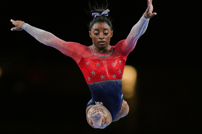 Simone Biles of United States of America competing in balance beam for women during the 49th FIG Artistic Gymnastics World Championships at the Hanns Martin Schleyer Halle in Stuttgart, Germany on October 8, 2019. [Photo: IC]