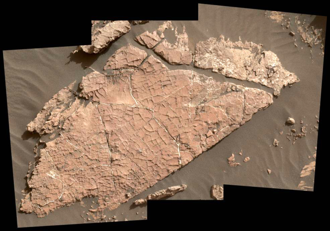 """The network of cracks in this Martian rock slab called """"Old Soaker"""" may have formed from the drying of a mud layer more than 3 billion years ago. The view spans about 3 feet (90 centimeters) left-to-right and combines three images taken by the MAHLI camera on the arm of NASA's Curiosity Mars rover. [Photo: nasa.gov/JPL-Caltech/MSSS]"""