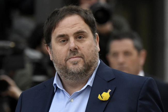 In this file photo taken on November 02, 2017 Catalan deposed regional vice president Oriol Junqueras arrives at the National Court in Madrid on November 2, 2017 to be questioned over his efforts to spearhead Catalonia's independence drive. [Photo: AFP/Gabriel Bouys]