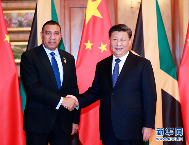 Chinese President Xi Jinping meets with Jamaican Prime Minister Andrew Holness in Shanghai, Nov. 4, 2019. [Photo: Xinhua]