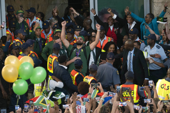 South African fans welcome their team's arrival at Johannesburg's O.R. Tambo airport Tuesday Nov. 5, 2019. South Africa defeated England 32-12 in the World Cup Rugby final Saturday Nov. 2 in Tokyo.[Photo: AP]