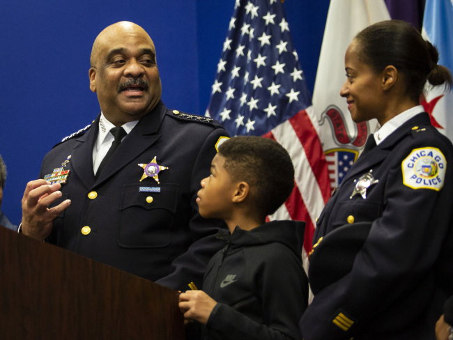 hicago Police Department Supt. Eddie Johnson looks back at his wife and 10-year-old son as he announces his retirement during a press conference at CPD headquarters, Thursday morning, Nov. 7, 2019. [Photo: AP]