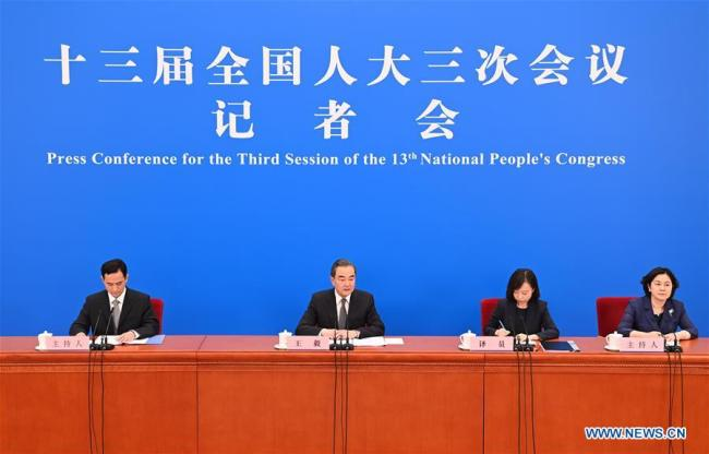 Chinese State Councilor and Foreign Minister Wang Yi (2nd L) attends a press conference on China's foreign policy and foreign relations via video link on the sidelines of the third session of the 13th National People's Congress (NPC) at the Great Hall of the People in Beijing, capital of China, May 24, 2020. [Photo: Xinhua]