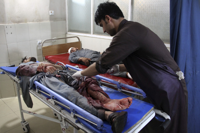 A wounded man receives treatment at a hospital after a suicide car bomb and multiple gunmen attack in the city of Jalalabad, east of Kabul, Afghanistan, Sunday, Aug. 2, 2020. A suicide car bomb and multiple gunmen attacked a prison in eastern Afghanistan on Sunday, Afghan officials said, killing at least one person and injuring dozens. [Photo: AP]