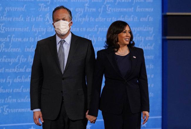In this Oct. 7, 2020, file photo, Kamala Harris stands with her husband Douglas Emhoff during the vice presidential debate with Vice President Mike Pence at Kingsbury Hall on the campus of the University of Utah in Salt Lake City. [Photo: AP /Patrick Semansky]